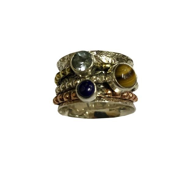 Кольцо прокручивающееся с тремя разными камнями серебро